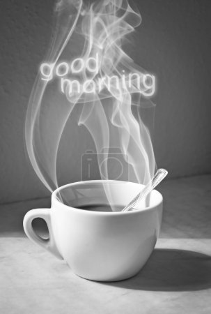 Cup of coffee with steam and good morning text