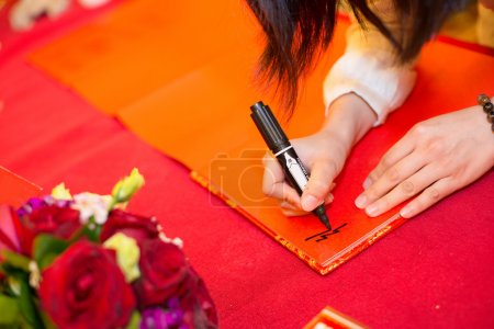 guests signing on the guestbook in a wedding
