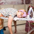 Woman tired ironed clothes and lay down on the iro...