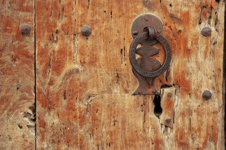 Old lock of a wooden door.
