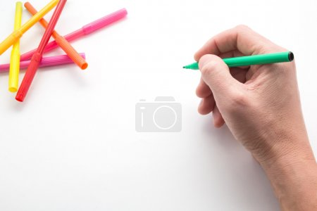 The mans hand, ready to draw a picture felt-tip pe...