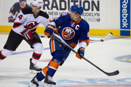 Photo pour New York Islanders captain John Tavares follows the play in this pre-season preview of the NY Islanders new home in the 2015-16 season in Brooklyn New York - image libre de droit