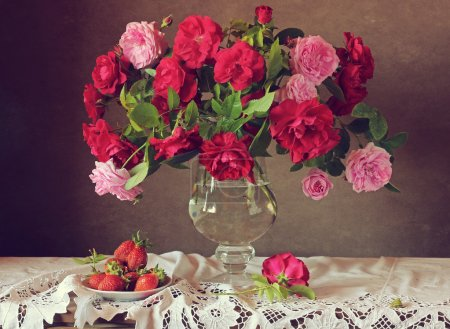 Photo for Still life with roses and strawberry on a white cloth with laces - Royalty Free Image