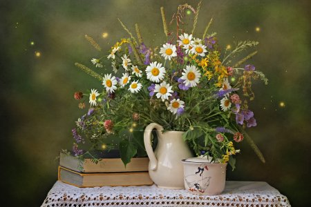 Photo for Still life with a bouquet of wild flowers, books and a sugar bowl with drawing on an indistinct multi-colored background - Royalty Free Image