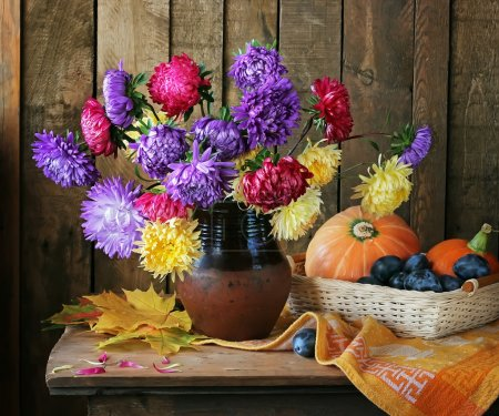 Still life with a bouquet from asters and chrysanthemums