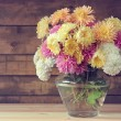 Yellow, white and pink chrysanthemums in a transpa...
