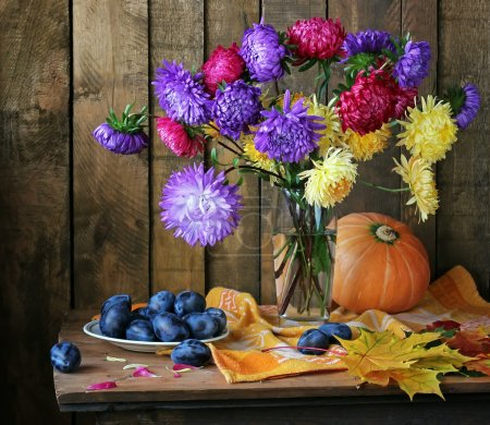 Still life with asters, pumpkin, plums and autumn ...