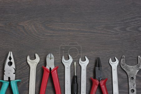 Set of tools against a dark background.