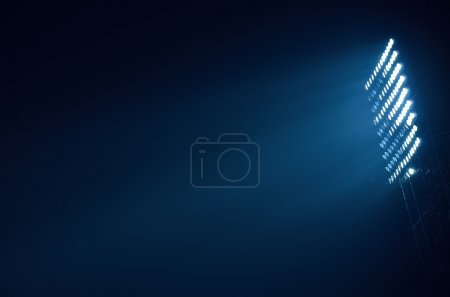 Photo for Stadium floodlights against a dark night . - Royalty Free Image