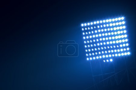 Photo for Close-up of stadium floodlights against a dark night sky background - Royalty Free Image