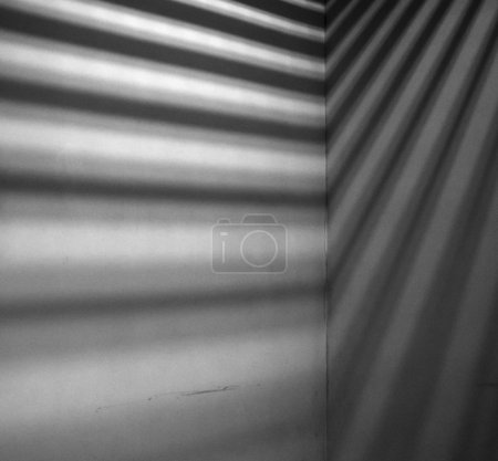 Lights and shadows falling on corner  concrete wall
