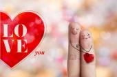 Ujj art. Szerelmesek átfogó és gazdaság piros szív. Stock kép