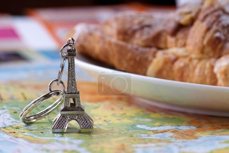 Eiffel tower keychain and croissant