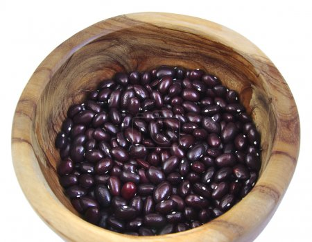 Top view of uncoocked red beans in a olive wood bo...
