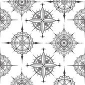 seamless pattern with compasses drawn with floral elements