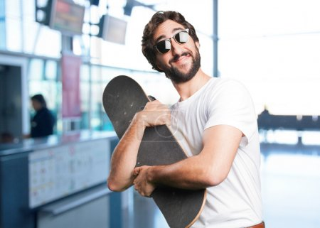 young funny man with skateboard