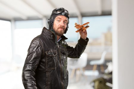 blond pilot with toy plane