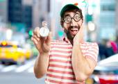 crazy young man with stopwatch