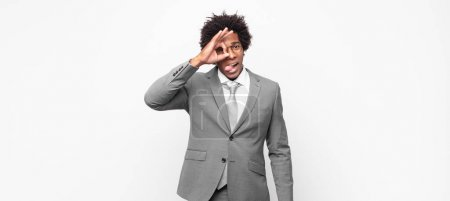 Black afro businessmansmiling happily with funny f...