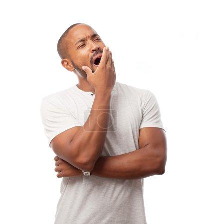 Young cool black man yawning