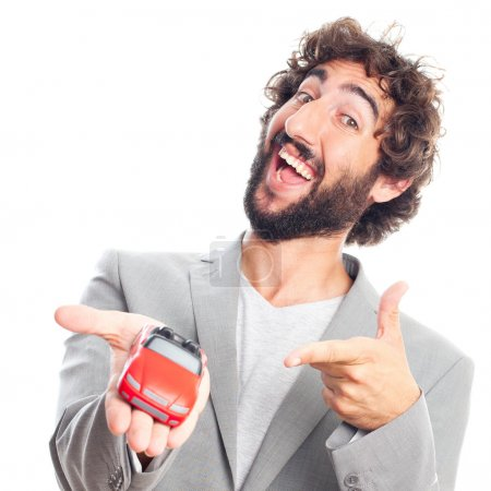 Photo for Young crazy man with a car toy - Royalty Free Image