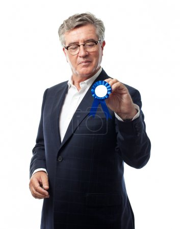 Senior cool man with a medal