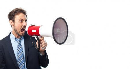 Young crazy businessman with a megaphone