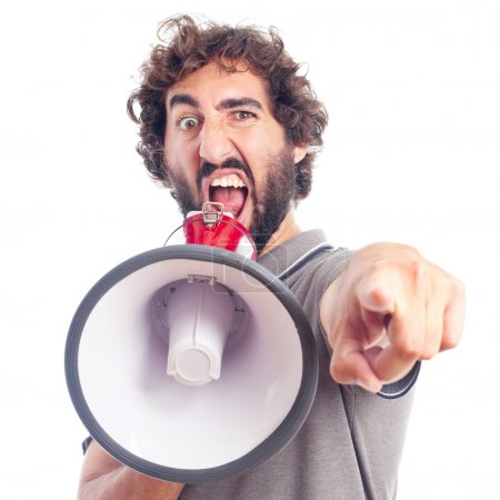 Photo for Young crazy man angry with a megaphone on white background - Royalty Free Image