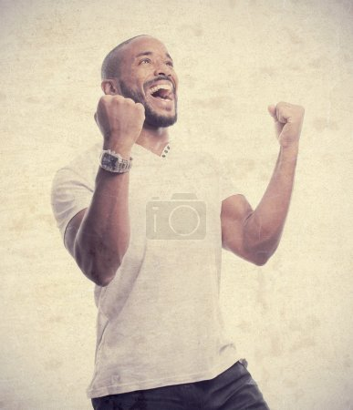 Young cool black man celebratin sign