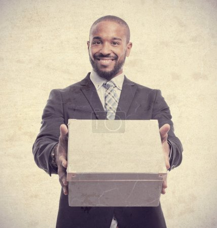 Young cool black man with a box