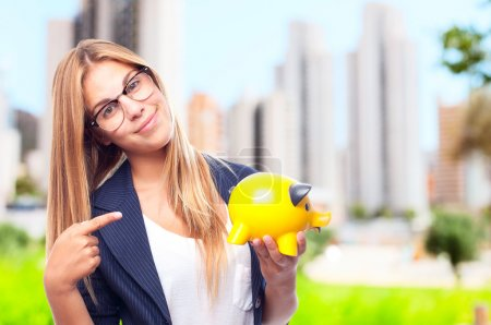 young cool woman with a piggy bank