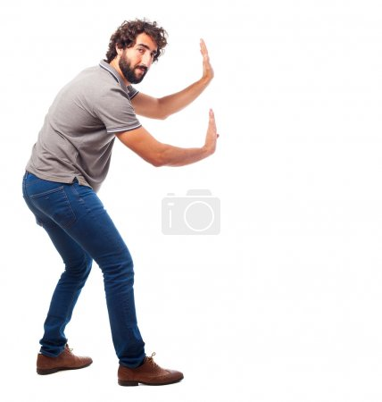 young crazy man push gesture