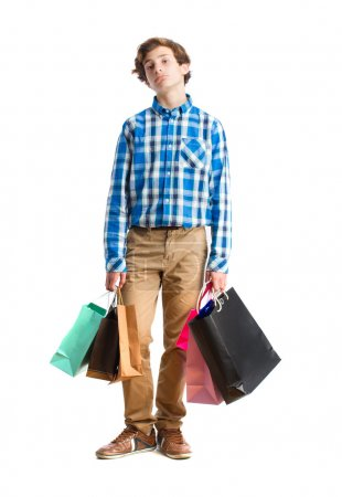 Boring teenager holding shopping bags