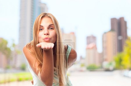 young cool woman sending a kiss