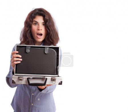 Astonished girl opening a briefcase