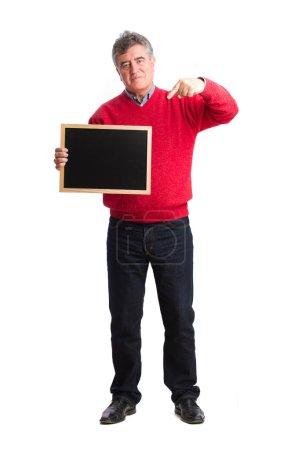 Satisfied man holding a blackboard