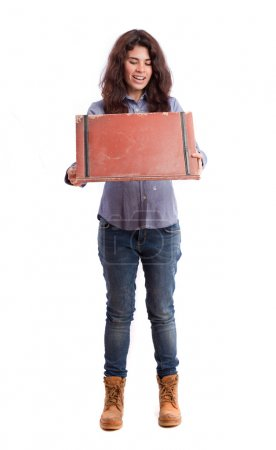 Surprised girl opening a leather wallet