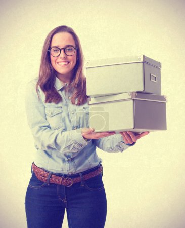 young woman holding a boxes. isolated