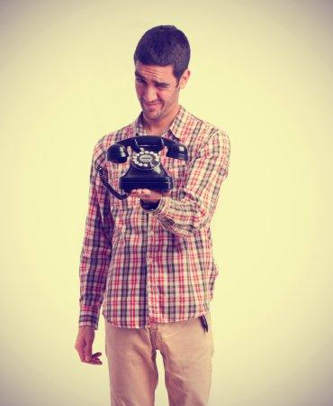 Proud boy holding a telephone