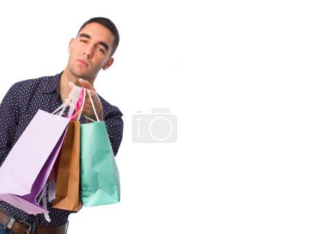 Photo pour Jeune homme avec des sacs à provisions - image libre de droit