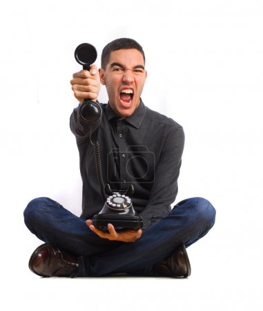 young man shouting on a telephone