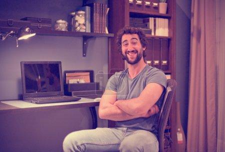 Happy man in office