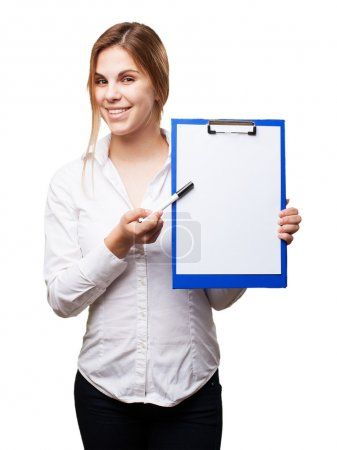 blond woman with paper and pen