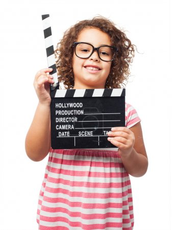 black girl with a clapperboard