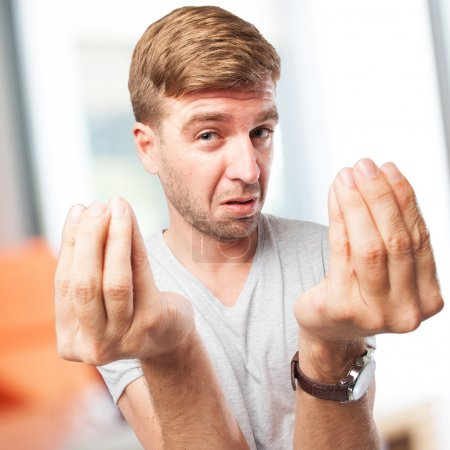 blond man confused gesture