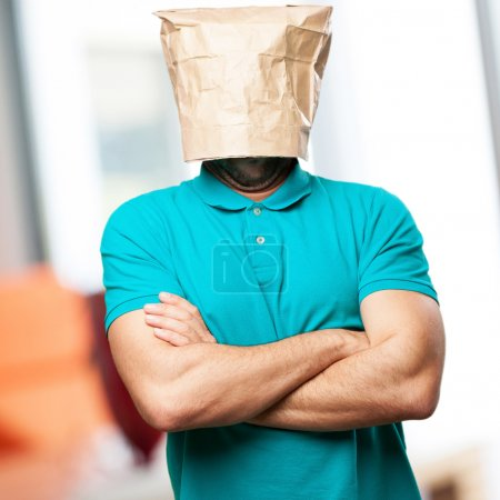 sad man with a paper bag in his head