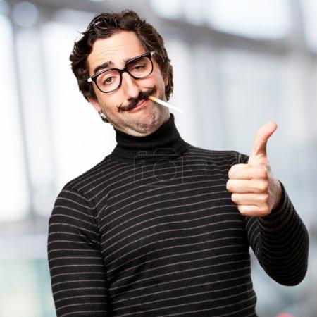 pedantic man smoking