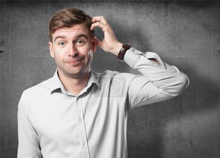 Photo pour Blond homme doutant - image libre de droit