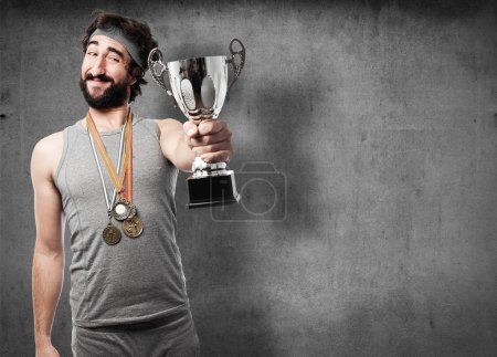 sportsman with medals and cup