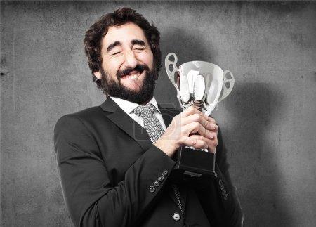 Photo pour Homme d'affaires avec une tasse gagnante - image libre de droit